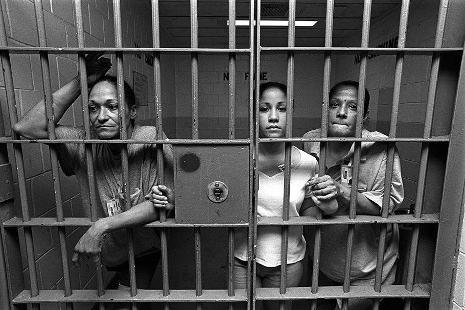 Three women in a jail cell.
