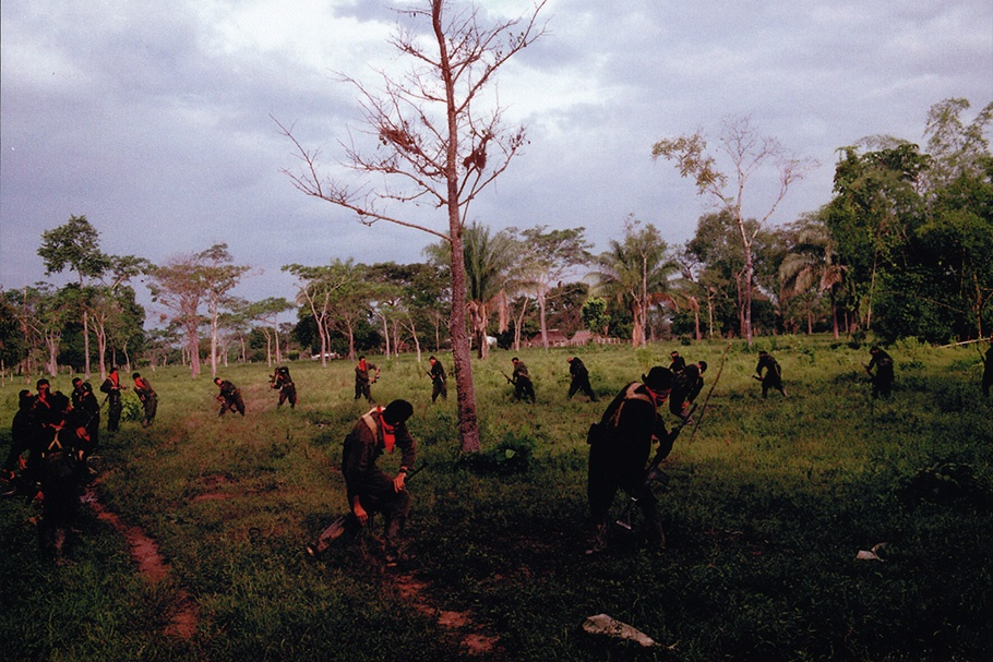 Guerrillas training in a clearing.
