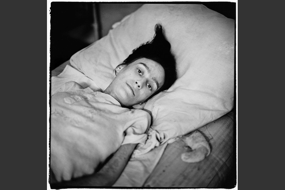 Hospital patient in a bed.