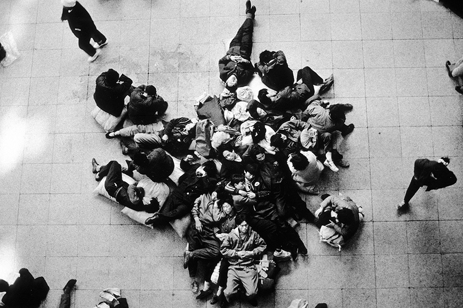 A group of people viewed from above.