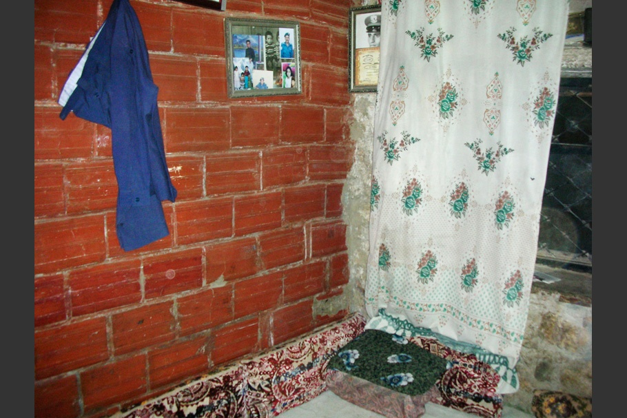 Interior with brick walls and hanging fabric.