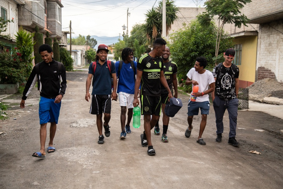 A group of men in soccer clothes walking