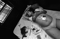 A pregnant woman lying on a bed.