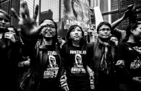 "Women at a protest, wearing shirts that say, ""Justice for Erwiana."""